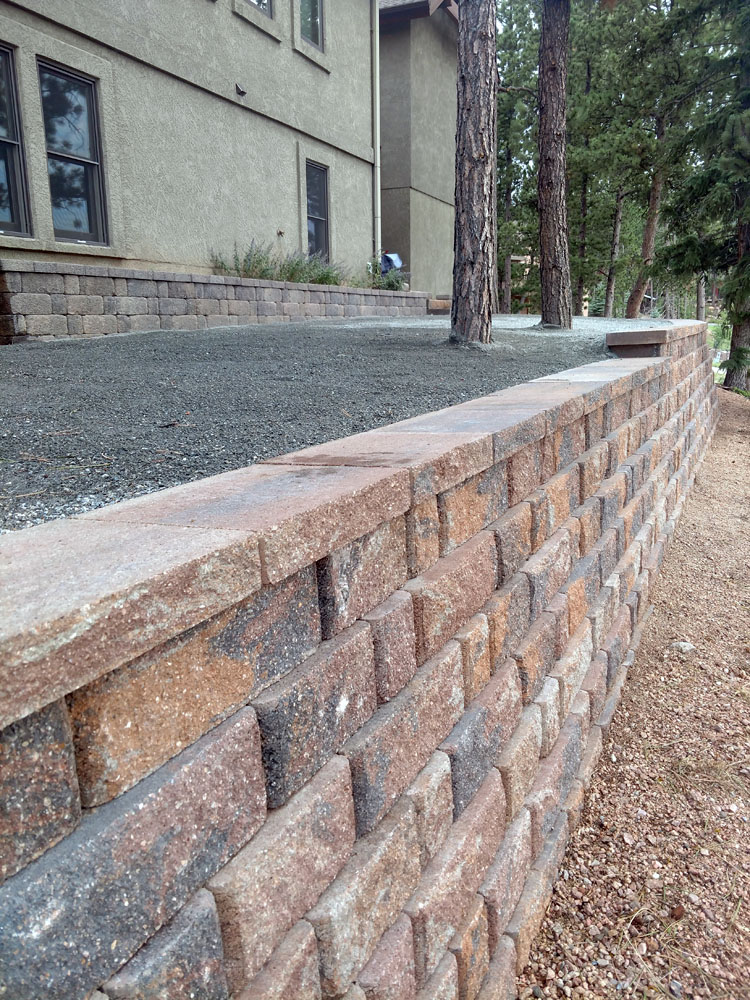 Block retaining wall designed to create more outdoor living area in Woodland Park Colorado