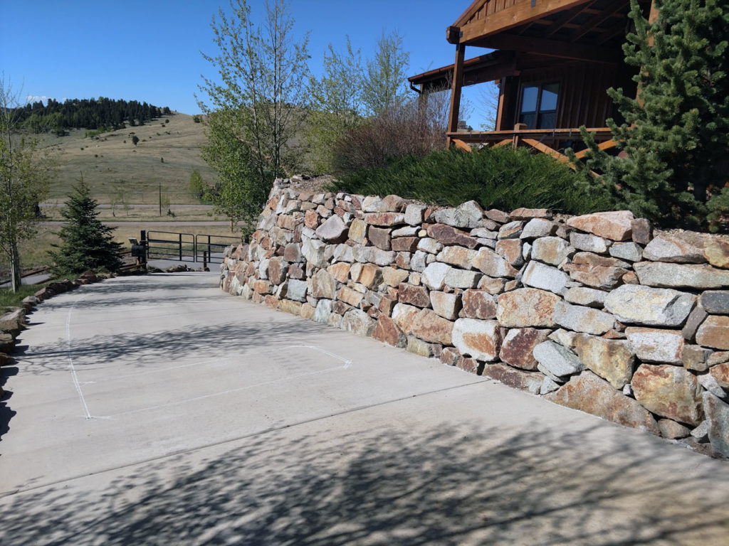 Boulder retaining wall and plantings in Cripple Creek CO