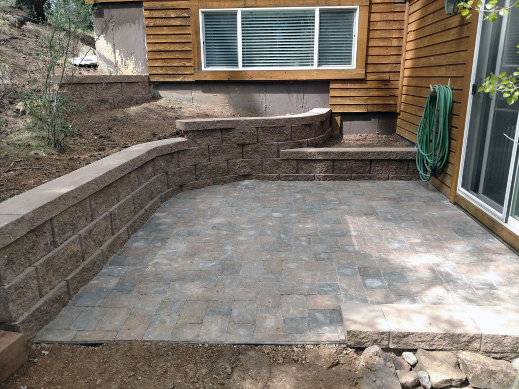 Drainage problems solved with block retaining wall and paver patio in Green Mountain Falls CO