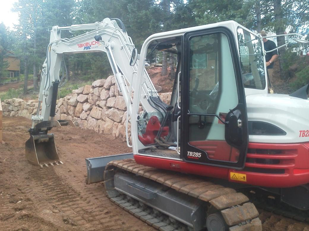 Drainage rerouting, driveway repair with excavator