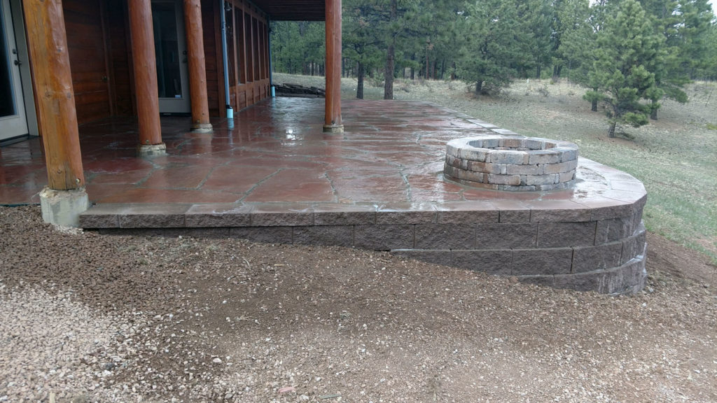 Flagstone patio with block retaining wall and firepit