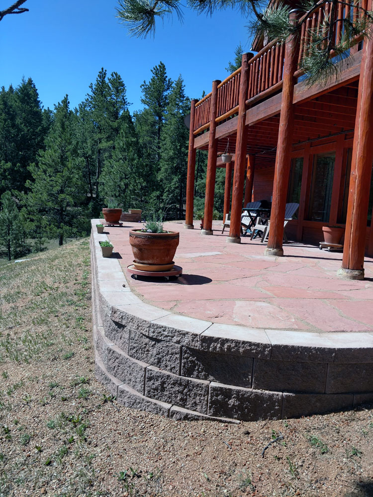 Flagstone patio with block retaining wall in Woodland Park CO