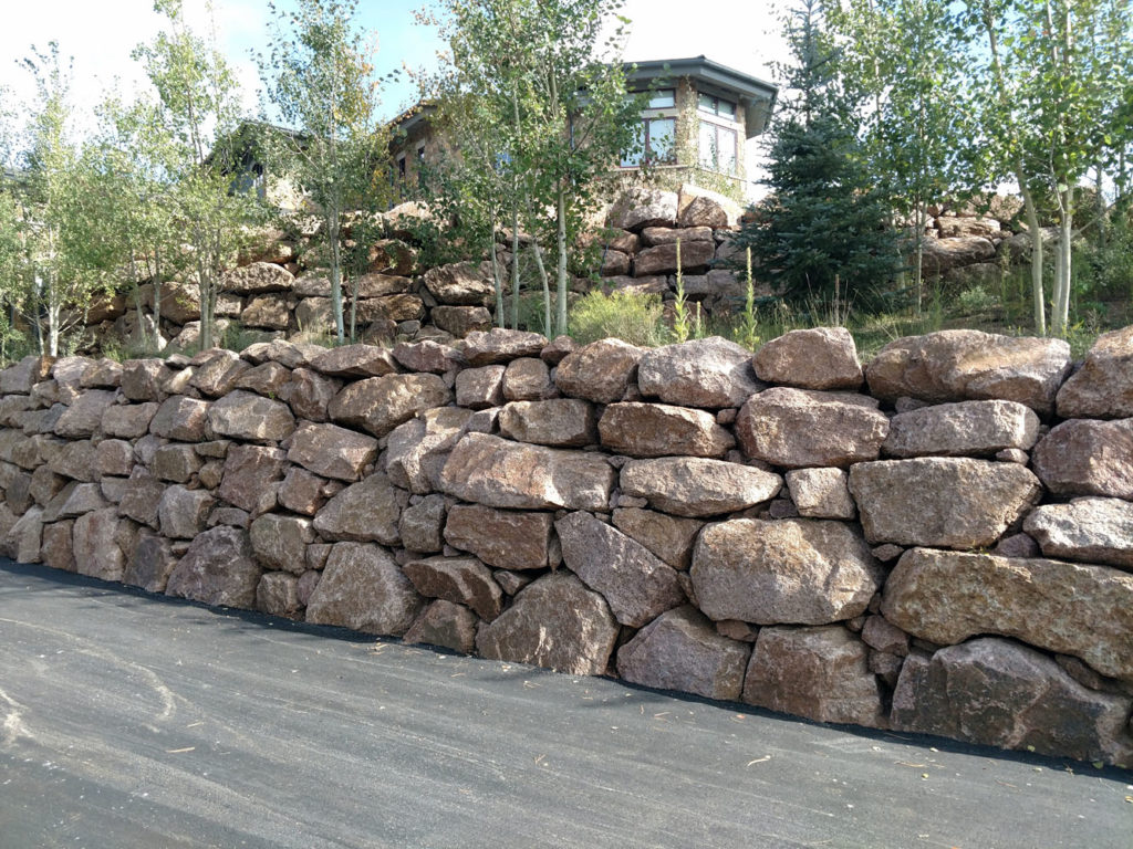 Multi-tier retaining wall with landings and plantings