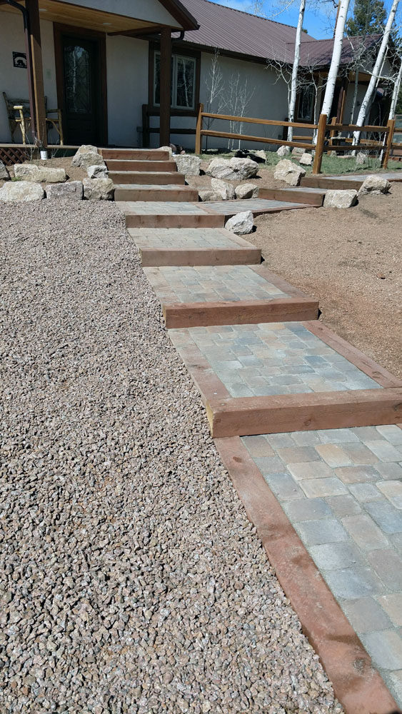 Paver walkway and stairs with timber border in Florissant Colorado