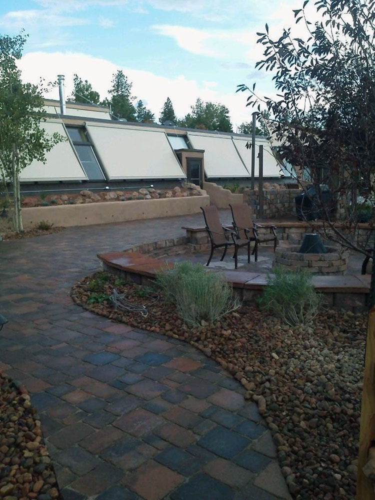 Paver walkway with set-in gathering area with block bench seating in Florissant Colorado