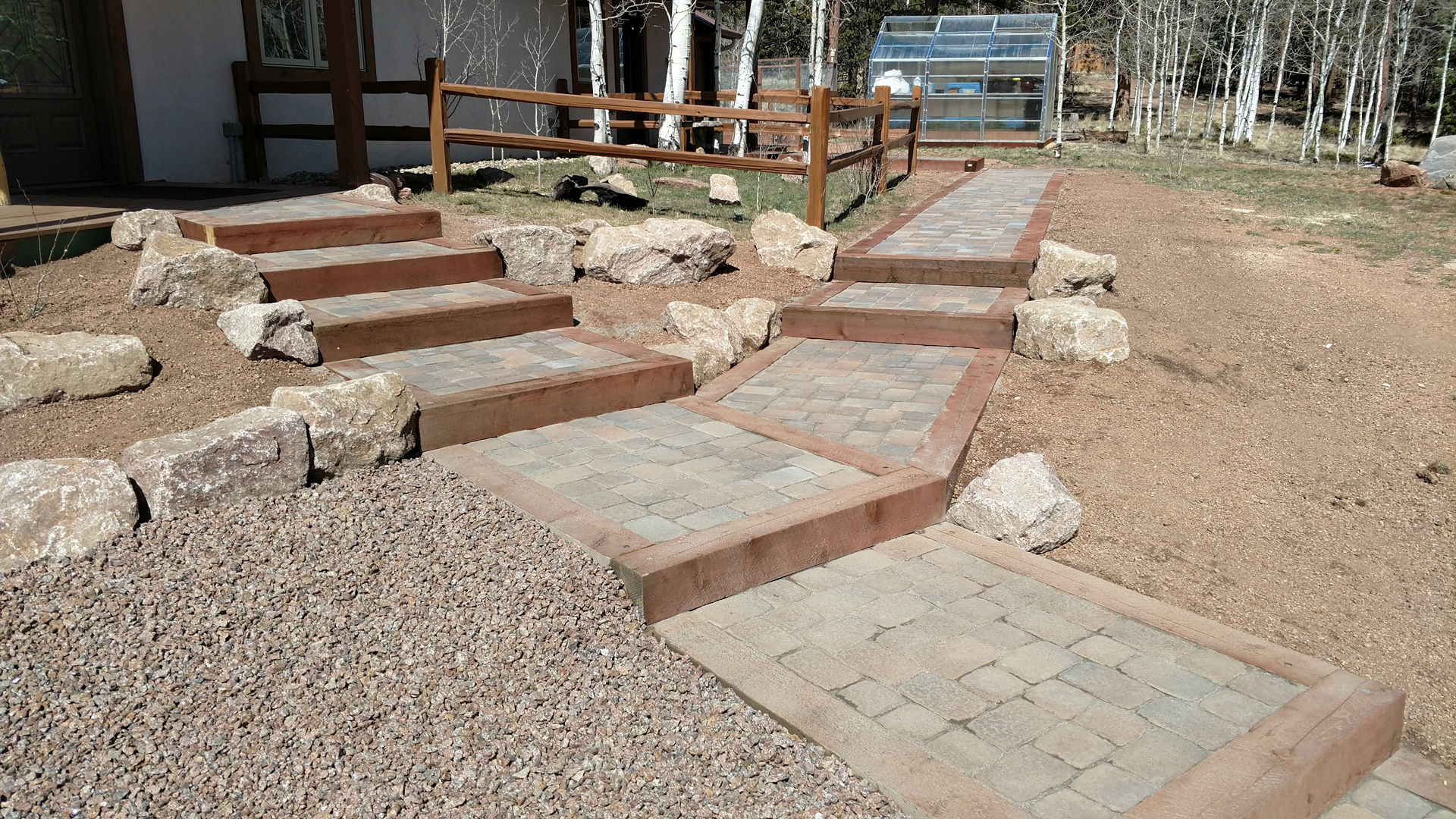 Paver walkway with timber border steps and boulder work in Woodland Park, Colorado