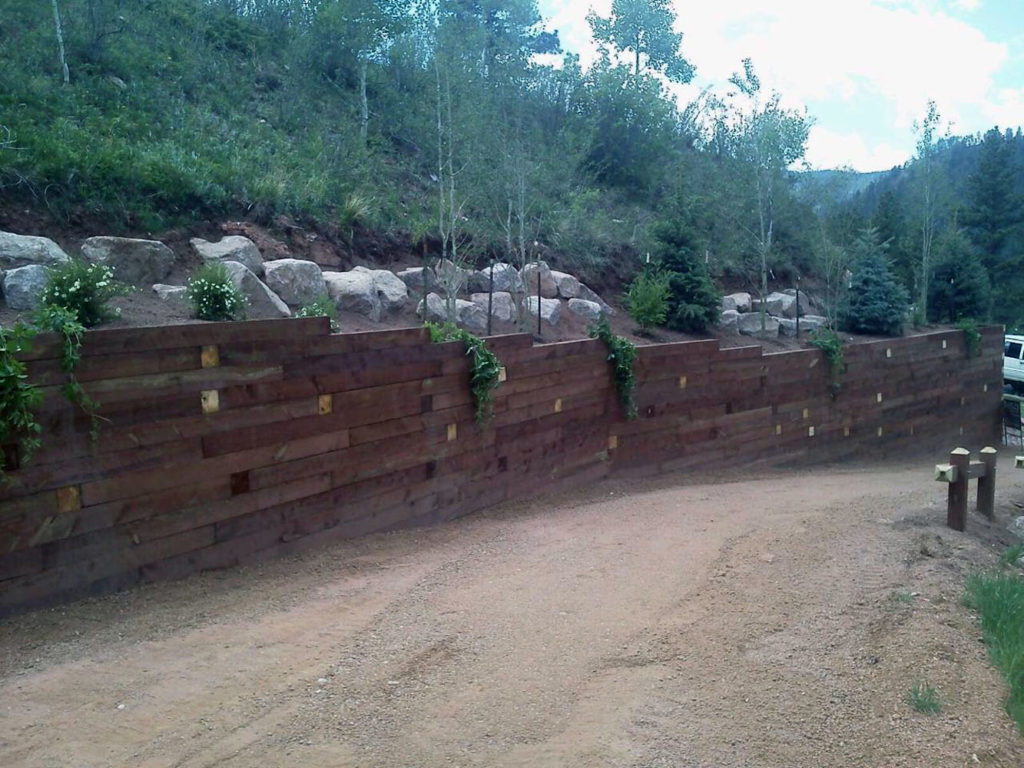 Timber retaining wall with plantings in Woodland Park CO