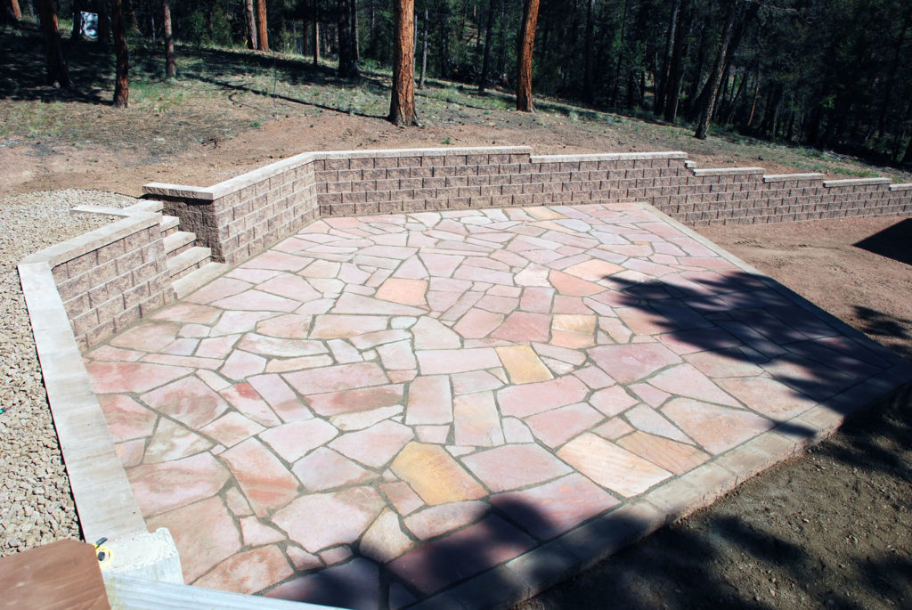 Flagstone patio with block retaining wall in Florissant, CO